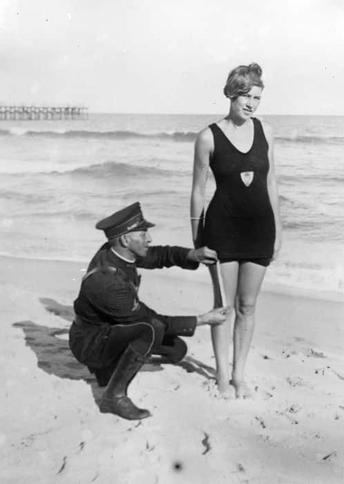Police officer measures woman's swimsuit at Palm Beach 1925
