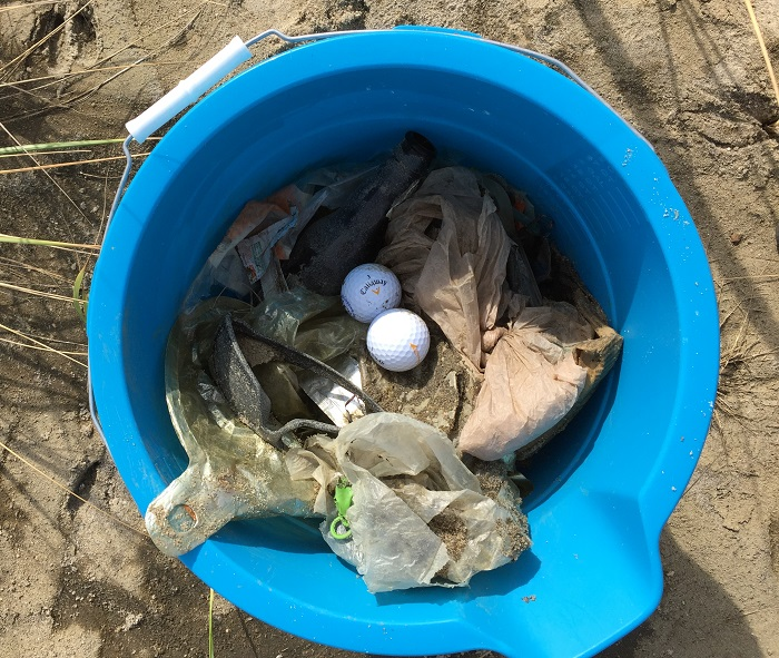 Bucket of trash collected at YNA Gunnison Beach Cleanup
