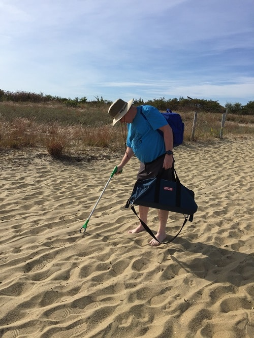 Picking up trash at YNA Gunnison Beach Cleanup