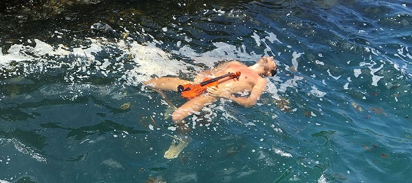 Glen Donnelly in the water with his violin