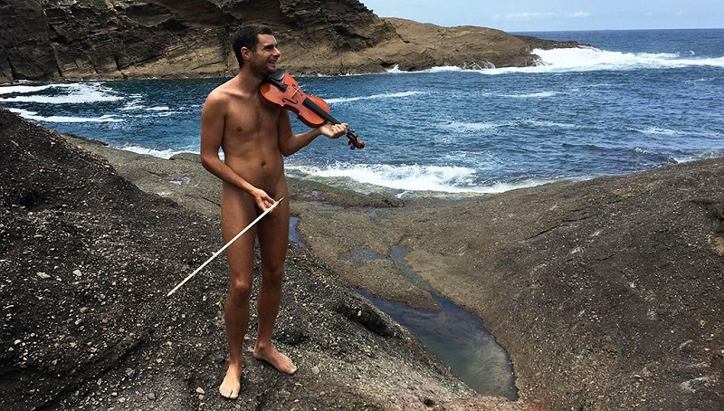Glen Donnelly on the beach with his violin