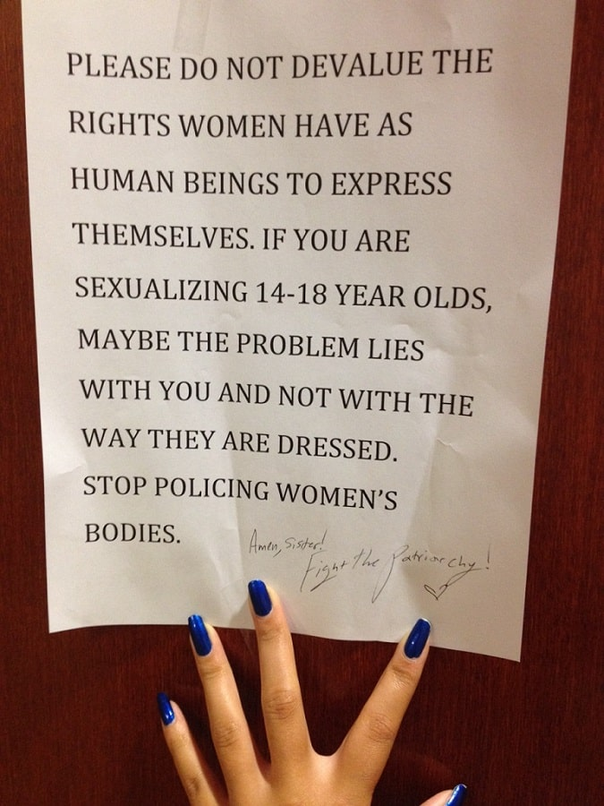 Protest sign against girls' school dress codes