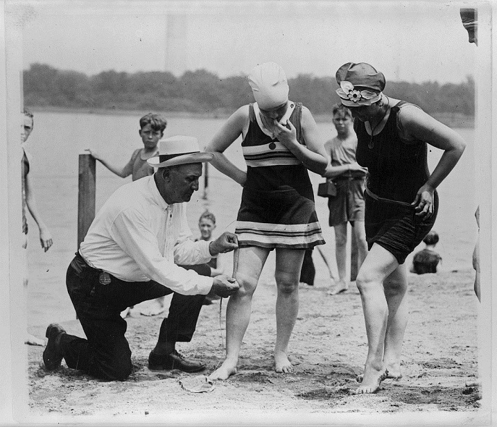Swimsuit policeman measures women's hems at Tidal Basin Beach in Washington