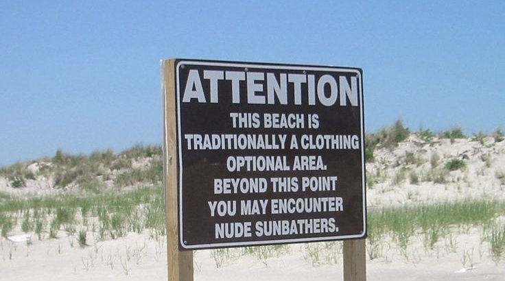 Nude sunbathers sign for clothing optional beaches