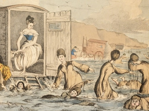 Victorian bathing machine with people swimming behind it